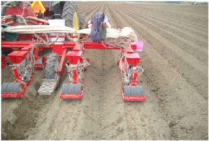 An Image Of A Vacuum Seeder Seeding 3 Lines Of Carrots Per Raised Bed